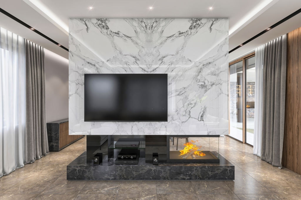 Luxury modern wall with large TV screen and fireplace.